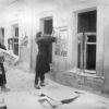 Комсомолки Полина Грязнова и Паня Петрова по заданию райкома комсомола развешивают плакаты в освобожденном г. Можайске. Январь 1942 г. РГАКФД